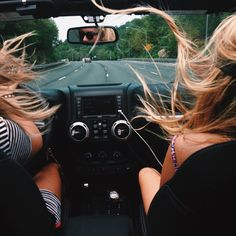 two blondes and a jeep