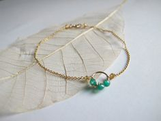 Green Onyx wire wrapped on tiny circle with 14k gold filled chain bracelet by Swallow Jewellery