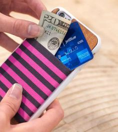 Slim down your pocket contents with this iPhone 6 case, which keeps a selection of cards handily nestled against your smartphone. Attached to a silicone snap-on case, the back panel is constructed from richly colored mahogany. The bumper protects your phone from wear and tear, and the stretchy elastic band fits a small stack of cards. With several color options to choose from, there's one to suit every taste.