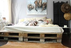 Peacefull DIY bedroom with futon bed made out of pallets