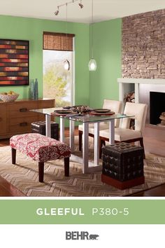 We can't help but smile when we catch a glimpse of BEHR® Paint in Gleeful. This bright green wall color makes for a fun addition to this dining room. Pair with neutral white accents, wood tones, and pops of red to recreate this look. Click below to learn more. Furniture, Room, Interior, Green Wall Color, Home Decor, Green Painted Walls, Room Colors, Green Wall, Wall Color