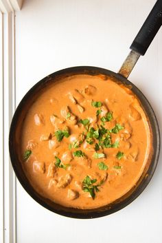 Chicken tikka masala has tender chicken marinated in yogurt and Indian spices, then grilled and served in a creamy, spicy tomato sauce with naan and rice.