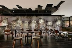 Urban bakery café by Joey Ho Design, Hong Kong. Nice chiselled plaster graphics