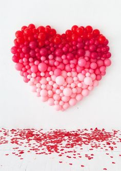 Giant ombré heart balloon backdrop. The perfect DIY decoration for a Valentine's Day party!