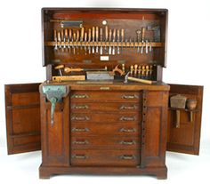 A rare MELHUISH Work Bench Tool Cabinet in polished figured mahogany