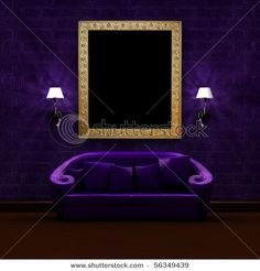 Stock Photo: Purple couch with antique picture frame and sconces in dark minimalist interior