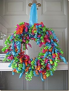 lovely colorful ribbon wreath~ Great Birthday Party decoration!  Jennifer, I thought of you when I saw this wreath. You could even do green and red for Christmas or yellow and purple for Easter.....I am thinking of trying a red and black for school