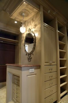 Jewerly storage area for my closet. I love this idea. I can lay out my jewery on the table under the wonderful lighting and have a mirror to check it out! :)