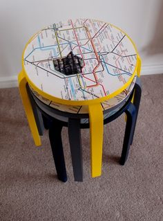 Recycled stools with subway maps