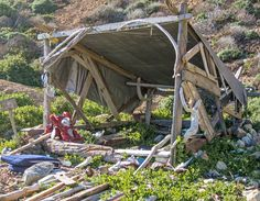 This is a shack that I built on a remote beach about 5 years ago. (It's such a long hike that I've never seen anyone at this spot.) I used hammer and nails. I kept a tarp stashed behind some ... Read More