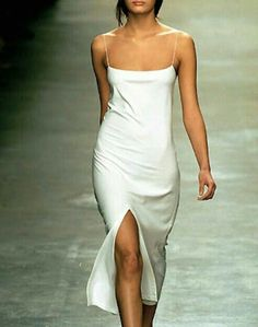 This slip is Calvin Klein from the The slip dress came back in style around 1991 and was called the lingerie look. It was very simple and easy and was seen on a lot of celebrities throughout the Addie Medica Look Fashion, 90s Fashion, Runway Fashion, High Fashion, Vintage Fashion, Fashion Design, Dress Fashion, Womens Fashion, Fashion Clothes