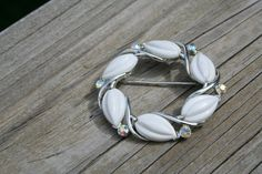 Vintage brooch with white cabochon and rhinestones by GeniceRill, $7.00