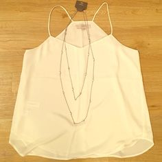 LOFT tank! White/cream spaghetti strapped tank top. Pairs great with the matching cardigan. Can we work with jean capris, skinny jeans, or black skinny pants. LOFT Tops Tank Tops