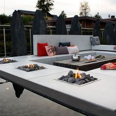 Interesting and ultra modern fire pit table by Haddeland Design.