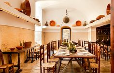 The Fortress' former kitchen, in typical Mallorcan style, has been refurbished to offer a private dining room, where wine tastings and cooking classes are organized. #caprocat