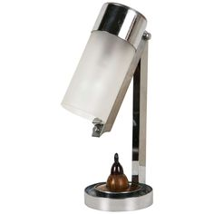1930s Art Deco Modernist Table Lamp by Jean Boris LACROIX in chrome metal, the articulated head on the shaft is ending w/ a frosted glass cylinder. Bakelite switch on the wooden base. (hva)