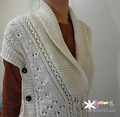 Vests are perfect for winter, and this gorgeous tunic features a fashionable shawl collar. (Lion Brand Yarn)