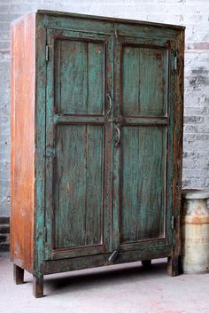 A true vintage cabinet from a village just outside of Jodhpur, India. The curio has naturally worn paint with a patina from many years of