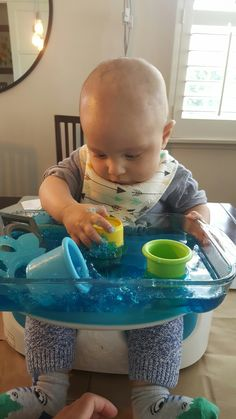 """Jello Sensory Play"".  It helps with the fine motor skills, great for children when teething, and child will be intrigued for at least 20 mins."