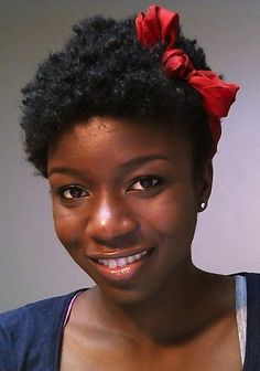 Natural hair with headband bow.  TWA mini afro.  Looking great.