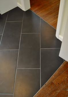 nice metal transition piece between hardwoods + tile Grey Floor Tiles, Entryway Tile Floor, Gray Tile Floors, Kitchen Floor Tiles, Wooden Floor Tiles, Entry Tile, Tile Wood, Hardwood Tile, Wood Tile Floors
