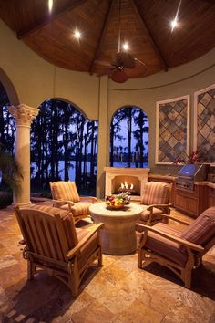 While this#outdoorlivingspace is enviable, I'm not sure how the interior would stand up to smokey BBQ's under this roof.