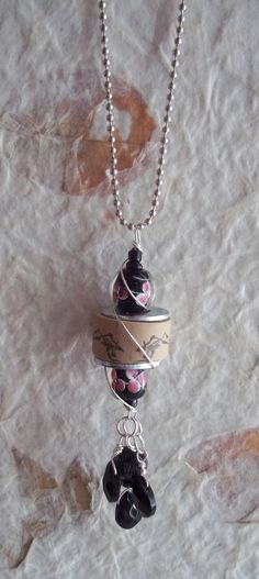 Wine cork necklace with pretty lamp work beads.