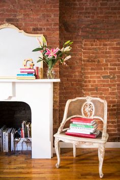 Exposed brick and pretty blooms. | http://domino.com