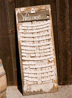 Got an old door banging around?? voila!!...wedding escort cards on old door