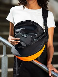 Made from black 100% Nylon with a silky feel, this moon-shaped crossbody has a practical internal zippered pocket and features a detachable eyewear pouch positioned under the flap. The main compartment is extendable; the zip at the base of the bag opens up to reveal a panel of bright orange, bringing an optional splash of colour to this black bag while increasing the volume. The ADDA shoulder strap can also be worn separately as a minimal crossbody. Moon Shapes, Orange, Yellow, Refashion, World Of Fashion, New Product, Color Splash, Shoulder Strap, Crossbody Bag