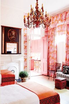 Manuel Canovas pink and orange toile wallpaper and fabric in a bedroom. SIde chair covered in a David Hicks fabric. «design :: melissa miles ruffy»
