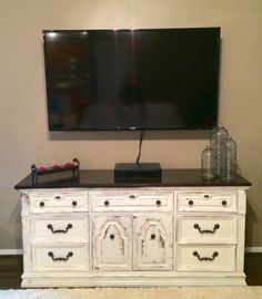 Using dressers for entertainment stands is popular right now and this piece is a stand out!