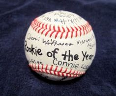 """""""rookie of the year"""" Guests sign a baseball"""