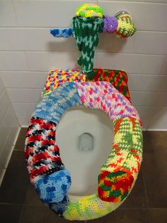 @Jamie 'Nowlan' Wyattbathroom bomb!  hahahahaha..LOL Jamie this made me laugh for two reasons~ 1)because yarn bombing is hilarious and 2) maybe if you had this E wouldn't set off the glass shattering alarm!!!  :)