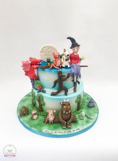 Julia Donaldson cake with 'Room on the Broom', 'The Gruffalo', 'Stick Man' and 'What the Ladybird Heard'.