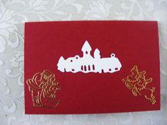 dubbele rode kaart voorkant met stans(dorpje) en stickers