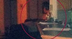 APPARITION IN KITCHEN! The picture of the kitchen bar looking into the living room is of a lady leaning on the bar in the middle upper in the picture, its hard to see it at first but its a woman's face and you can clearly see how her face features blends in with the background of the picture. Her eyes are closed. She has a big nose and head tilt down just a little and you can see her lips and her black hair. She looks sad. Submitted by: Christy, J. Paranormal 360