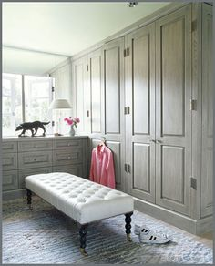 Possible way to include more storage space in our master bedroom without having furniture stacked all around the walls - built in cabinetry/armoires?   Greige dressing room cabinetry; George Smith bench; Jeffrey Alan Marks