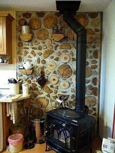 A double wall cordwood, strawbale kitchen in Manitoba. The lovely home of Clint and Cindy Cannon. Simply outstanding cordwood log placement. www.cordwoodconstruction.org