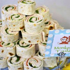 """""""Monkey Tail"""" Sandwich Rolls are a super easy way to add another delicious main course item to your Sock Monkey themed party menu. Just make a """"Monkey Tail"""" sign to put in front of your purchased or home made sandwich rolls."""