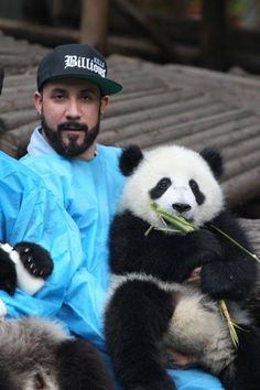 AJ McLean - Members of the Backstreet Boys hold giant pandas at the Giant Panda Breeding Research Institute during their China Tour on May 30, 2013 in Chengdu, Sichuan Province of China. (Photo by ChinaFotoPress/ChinaFotoPress via Getty Images)