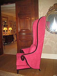 high back wing chair..love the details on the arms,hot pink