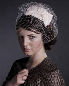 lovely birdcage bridal hairpiece