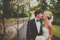 Wedding photos. Iron gate. Legare Waring House, Charleston SC. ELM events. http://hyerimages.com
