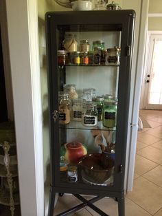 Baking curio using Ikea Fabrikör glass and metal cabinet. Everything together in one easy-to-see, lovely location.