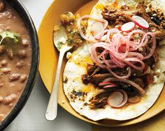 This dish can be made vegetarian by omitting the bacon. A final flourish of sharp Cotija cheese, cilantro, and pickled onions adds color and texture.