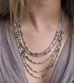 Mixed metal beads of gold, silver, gunmetal & copper hand-strung into a 5-tiered multi-strand necklace. Subtle shine & elaborate style. Worn a variety of ways, simple enough with jeans & a white T-shi