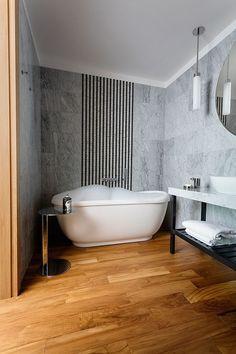Agnes Rudzite Interiors bathroom - bianco carrara walls & teak floor, marble stripes