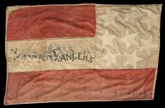 """Two-sided pieced silk Confederate battle flag is painted on the white stripe """"Our Rights"""" and"""" [Claib]orne Rangers"""". The flag was captured from a mounted company of the 12th Louisiana Regiment by the 4th Minnesota Regiment on May 14, 1863 at Jackson, Mississippi."""