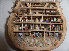 HMS Victory, cross section model. The rocks at the bottom are for ballast. Model Sailing Ships, Old Sailing Ships, Model Ship Building, Boat Building, Ship Figurehead, Bateau Pirate, Scale Model Ships, Hms Victory, Ship Of The Line